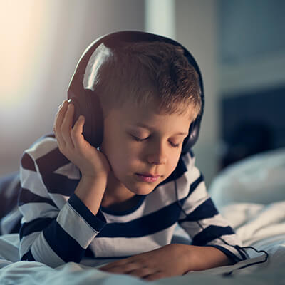 A boy wearing headphones